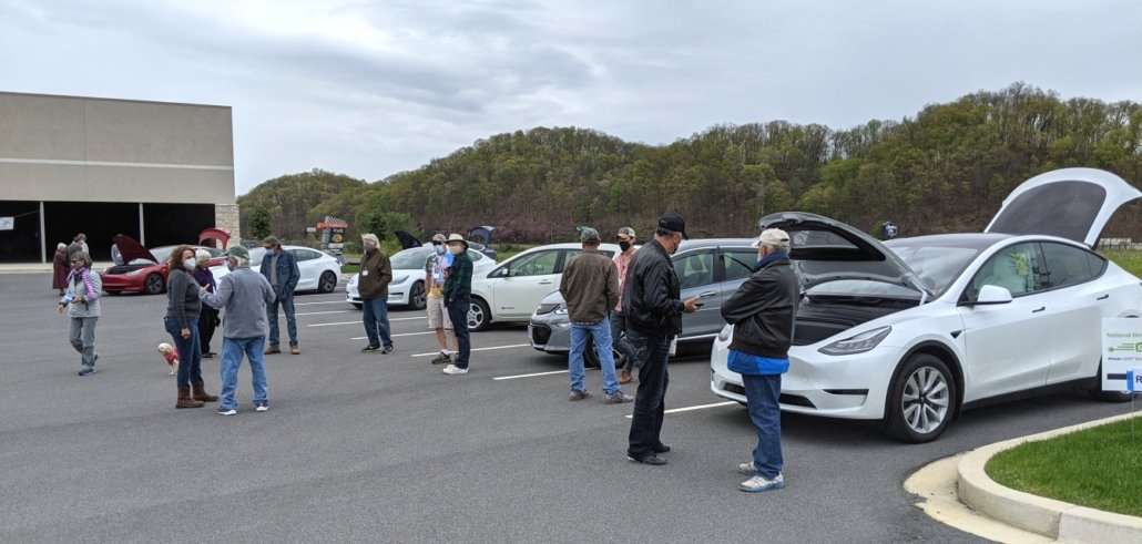 People seeing electric vehicles at Drive Electric Earth Day Event
